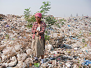"""25 FEBRUARY 2008 -- MAE SOT, TAK, THAILAND: Burmese refugees and migrants work in the landfill in Mae Sot, Thailand. There are millions of Burmese migrant workers and refugees living in Thailand. Many live in refugee camps along the Thai-Burma (Myanmar) border, but most live in Thailand as illegal immigrants. They don't have papers and can not live, work or travel in Thailand but they do so """"under the radar"""" by either avoiding Thai officials or paying bribes to stay in the country. Most have fled political persecution in Burma but many are simply in search of a better life and greater economic opportunity.    PHOTO BY JACK KURTZ"""