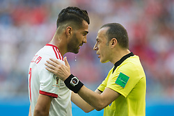 June 15, 2018 - Saint Petersburg, Russia - Masoud Shojaei (L) of IR Iran national team argues with the referee Cuneyt Cakir during the 2018 FIFA World Cup Russia Group B match between Morocco and IR Iran on June 15, 2018 at Saint Petersburg Stadium in Saint Petersburg, Russia. (Credit Image: © Foto Olimpik/NurPhoto via ZUMA Press)