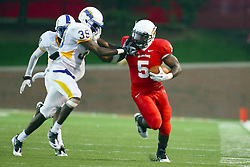 10 September 2011: Luke Boyd and Ashton Leggett exchange hands to the face as they approach the sidelines on a running play during an NCAA football game between the Morehead State Eagles and the Illinois State Redbirds at Hancock Stadium in Normal Illinois.