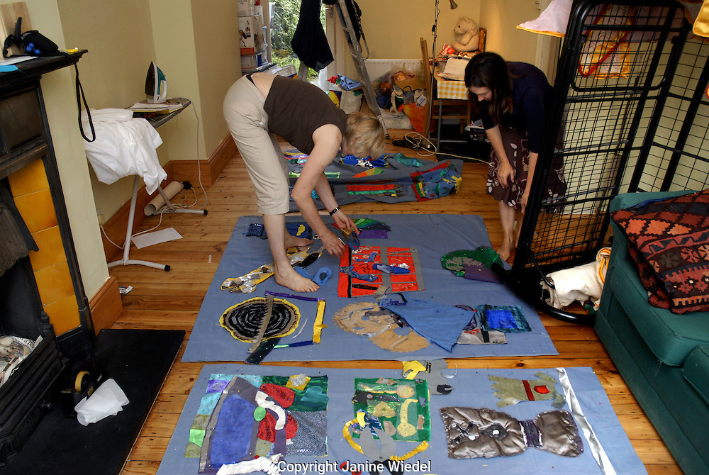 Women designing and making textile banners at home