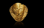 Mycenaean gold death mask, Mask of Agamemnon, Grave Cicle A, Mycenae, Greece.National Archaeological Museum of Athens.  Black Background<br /> <br /> The mask from Grave V depicts an imposing face of a bearded man descovered by  Heinrich Schliemann who believed it was the body of Agamemnon, this is unproven to date.  The Mycenaean death mask belonged to a warrior and made of gold leaf it cocered the dead mans face held on by cord threaded tgrough the two sides of the mask.  The mask of Agamemnon was created from a single thick gold sheet, heated and hammered against a wooden background with the details chased on later with a sharp tool. The artifact dates from the 16th century BC. .<br /> <br /> If you prefer to buy from our ALAMY PHOTO LIBRARY  Collection visit : https://www.alamy.com/portfolio/paul-williams-funkystock/mycenaean-art-artefacts.html . Type -   Athens    - into the LOWER SEARCH WITHIN GALLERY box. Refine search by adding background colour, place, museum etc<br /> <br /> Visit our MYCENAEN ART PHOTO COLLECTIONS for more photos to download  as wall art prints https://funkystock.photoshelter.com/gallery-collection/Pictures-Images-of-Ancient-Mycenaean-Art-Artefacts-Archaeology-Sites/C0000xRC5WLQcbhQ