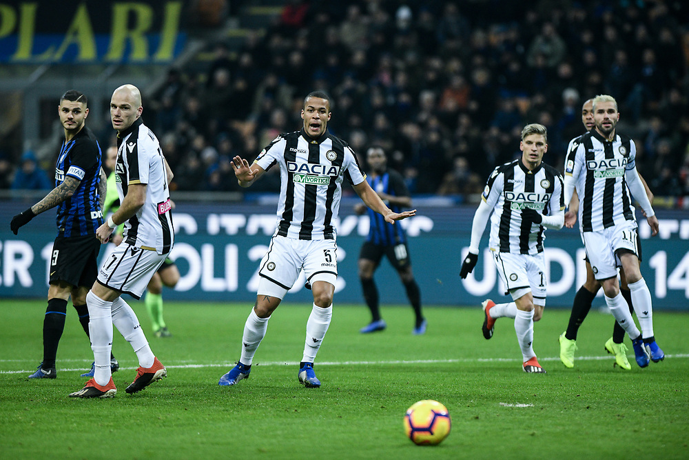 Forward Mauro Icardi (Inter), Defender Bram Nuytinck and Defender William Troost-Ekong look back at the ball during the Serie A football match, Inter Milan vs Udinese Calcio at San Siro Meazza Stadium in Milan, Italy on 15 December 2018