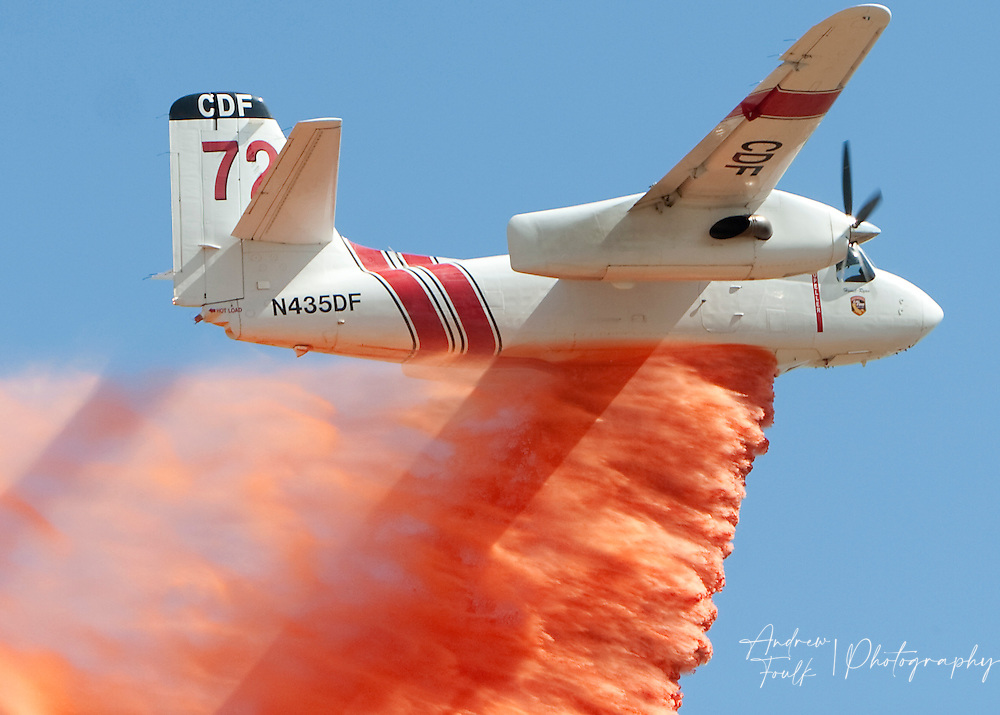 /Andrew Foulk/ For The Californian/ .A Cal fire air tanker makes a water drop over the Menifee Meadows Equestrian Center off of Briggs road in Menifee as a brush fire rages below.