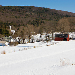 A field in winter at the Tyringham Cobble Reservation in Tyringham, Massachusetts.  Berkshire Mountains. The Trustees of Reservations.
