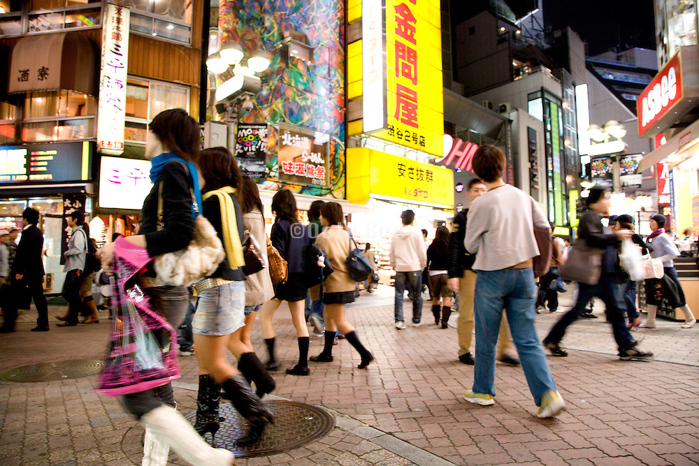 Friday evening meeting up and shopping in the Shibuya district of Tokyo Japan