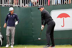 June 23, 2018 - Cromwell, CT, U.S. - CROMWELL, CT - JUNE 23: Rory McIlroy of Northern Ireland has a laugh with Lanto Griffin of the United States as a squirrel joins them on the first tee during the Third Round of the Travelers Championship on June 23, 2018, at TPC River Highlands in Cromwell, Connecticut. (Photo by Fred Kfoury III/Icon Sportswire) (Credit Image: © Fred Kfoury Iii/Icon SMI via ZUMA Press)