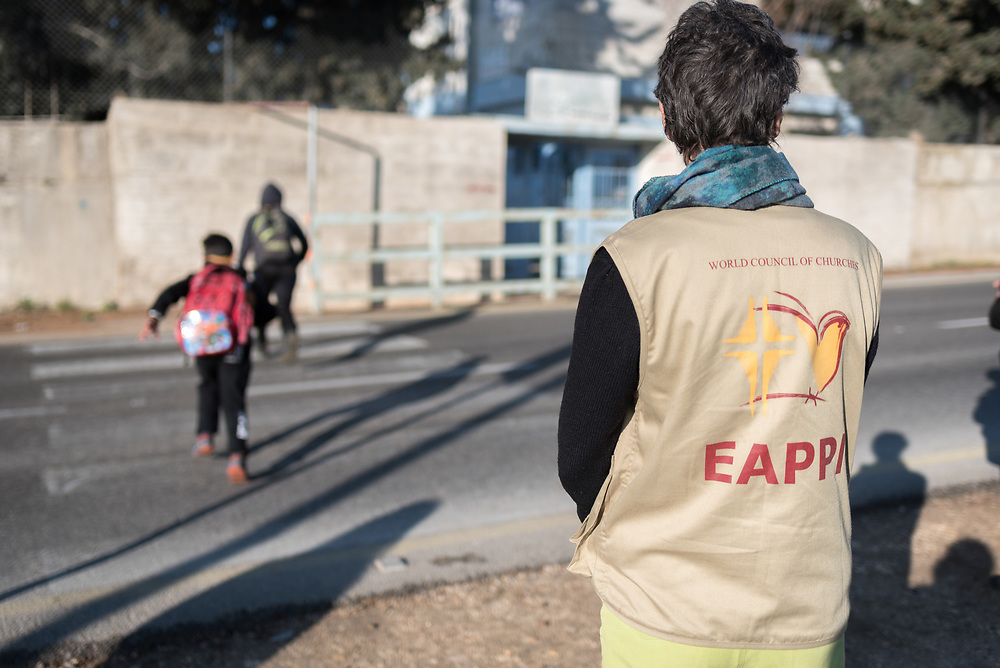 18 March 2019, Bethlehem, Occupied Palestinian Territories: Ecumenical Accompaniers from the World Council of Churches' Ecumenical Accompaniment Programme in Palestine and Israel spend the morning doing a 'school run', by which they offer a peaceful protective presence for Palestinian children as they go to school at Al Minya.  With Israeli settler communities nearby, strong military presence, and a high-speed road passing just by the school entrance, an international presence can help ensure safe passage for the children.
