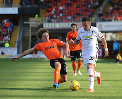 Dundee United's Aaron Kuhl and Inverness Caledonian Thistle's Miles Storey. <br /> Dundee United 1 v 1 Inverness Caledonian Thistle, SPFL Ladbrokes Premiership game played 19/9/2015 at Tannadice.