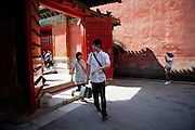 """Young couple entering """"The Forbidden City"""" which was the Chinese imperial palace from the Ming Dynasty to the end of the Qing Dynasty. It is located in the middle of Beijing, China. Beijing is the capital of the People's Republic of China and one of the most populous cities in the world with a population of 19,612,368 as of 2010."""