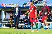 Portuguese national coach Fernando Santos, and team captain Cristiano Ronaldo giving instructions to team mates during Euro Cup Final against France. Portugal beat France on extra-time by 1-0 at Saint Denis stadium in Paris becoming European Champions for the first time.