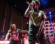 """WASHINGTON, DC - August 23rd, 2014 - Takeoff and Offset of Atlanta rap trio Migos perform at the 3rd annual Trillectro Music Festival at RFK Stadium in Washington, D.C. The group is known for their singles """"Versace"""" and """"Hannah Montana."""" (Photo by Kyle Gustafson / For The Washington Post)"""