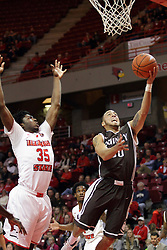 27 November 2015: Von Washington III under Roland Griffin(35) for a layup. Illinois State Redbirds host the Quincy Hawks at Redbird Arena in Normal Illinois (Photo by Alan Look)