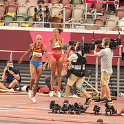 TOKYO, JAPAN August 1:   Yulimar Rojas of Venezuela is congratulated by Ana Peleteiro of Spain after breaking the world record with a leap of 15.67m during her gold medal performance in the Women's Triple Jump Final at the Olympic Stadium at the Tokyo 2020 Summer Olympic Games on August 1st, 2021 in Tokyo, Japan. (Photo by Tim Clayton/Corbis via Getty Images)