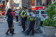 New York, NY USA August 3, 2016 --Pedestrians and public safety officers go about thier business in Times Square, New York. Editorial Use Only.