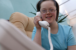 Teenage Downs Syndrome girl using the telephone,