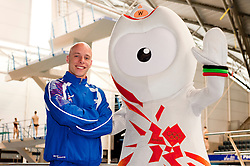 Team GB Diver Pete Waterfield (30) and Wenlock London 2012 Mascot beside the diving pool at Ponds Forge Sheffield..12 April 2011.Images © Paul David Drabble