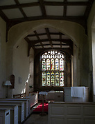 Interior of Saint Nicholas chapel, Gipping, Suffolk, England, UK view of east window and altar