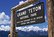 Wide angle view of the Grand Teton National Park Sign with the Teton mountains in the background