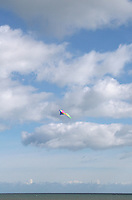 Colourful kite flying over beach in County Wexford Ireland