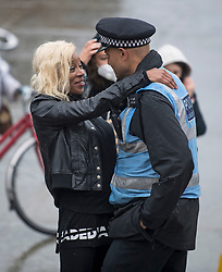 © Licensed to London News Pictures. 10/06/2020. London, UK. A Black Lives Matter campaigner hugs a police officer at the end of a Black Lives Matter march from Green Park to Trafalgar Square in London . Black Lives Matter have called for the removal of statues from throughout the UK, of historical characters involved in the salve trade, following the death of George Floyd in the U. S. A . Photo credit: Ben Cawthra/LNP