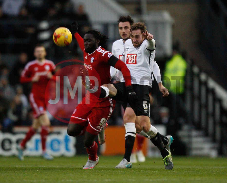 Kenwyne Jones of Cardiff City (L) and Richard Keogh of Derby County in action - Mandatory byline: Jack Phillips / JMP - 07966386802 - 21/11/2015 - FOOTBALL - The iPro Stadium - Derby, Derbyshire - Derby County v Cardiff City - Sky Bet Championship