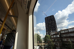 2 September 2017 - Charity Football - Game 4 Grenfell - A general view (GV) of the burned remains of Grenfell Tower from a train window - Photo: Charlotte Wilson