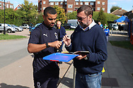 AFC Wimbledon striker Kweshi Appiah (9) signing autographs during the EFL Sky Bet League 1 match between AFC Wimbledon and Oxford United at the Cherry Red Records Stadium, Kingston, England on 29 September 2018.