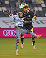 Nashville SC defender Walker Zimmerman (25) heads the ball against Sporting Kansas City forward Gianluca Busio (27) during the first half against at Children's Mercy Park.