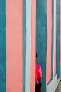 Woman and wall in Bayamo, Granma, Cuba.