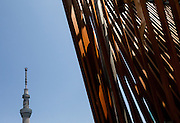 Tokyo Skytree Seen from behind a wooded sculpture in Asakusa, Tokyo, Japan. Friday May 16th 2014