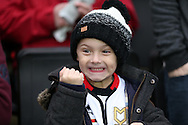 a Young MK Dons fan shows his delight as he cheers his team on . The Emirates FA cup, 4th round match, MK Dons v Chelsea at the Stadium MK in Milton Keynes on Sunday 31st January 2016.<br /> pic by John Patrick Fletcher, Andrew Orchard sports photography.
