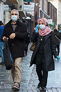 Shoppers wear face coverings and gloves to help prevent the spread of the coronavirus on 10 October 2020 in Windsor, United Kingdom. The Royal Borough of Windsor and Maidenhead has seen a significant rise in the COVID-19 infection rate over the past week, giving it the second-highest infection rate in South-East England outside London.