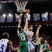 Anadolu Efes's Stratos Perperoglou (C) during their Turkish Basketball League match Anadolu Efes between Darussafaka at Abdi Ipekci Arena in Istanbul Turkey on Wednesday 24 December 2014. Photo by Aykut AKICI/TURKPIX