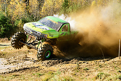 """The """"Bad Frog"""" megatruck lands after blasting through the mud pit during the Monstober monster truck/mudbog show at the Belknap County 4H fairgrounds on Saturday October 19, 2019.(Alan MacRae for the Laconia Daily Sun)"""