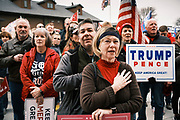 """06 DECEMBER 2020 - DES MOINES, IOWA: People say the Pledge of Allegiance during a rally in support of President Donald Trump. About 1,000 supporters of outgoing US President Donald Trump rallied in Des Moines Sunday to show their support for the President and to protest the outcome of the US Presidential election. They started with a rally in the suburbs of Des Moines then drove in a motorcade through the city, ending at the State Capitol. They repeated many of Trump's discredited claims that the election was marked by fraud and that Trump actually won. The protest was a part of the national """"March for Trump"""" effort, culminating in a march in Washington DC on December 13. Joe Biden won the election, with 306 electoral votes to Trump's 232.       PHOTO BY JACK KURTZ"""
