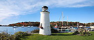 A Small Decorative Lighthouse And Boats In Harbor At Kennebunkport, Maine, USA, Panoramic View