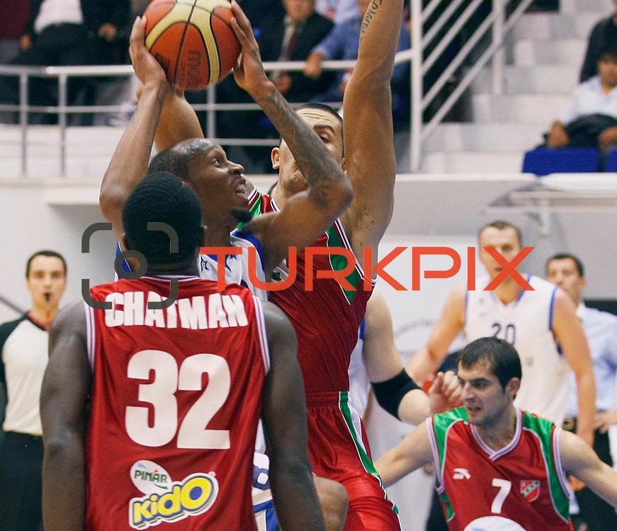 Anadolu Efes's Terence KINSEY (C) during their Turkey Cup Qualifying basketball second match Anadolu Efes between Pinar Karsiyaka at Aliaga Arena in Izmir, Turkey, Monday, October 10, 2011. Photo by TURKPIX
