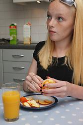 White girl eating an orange