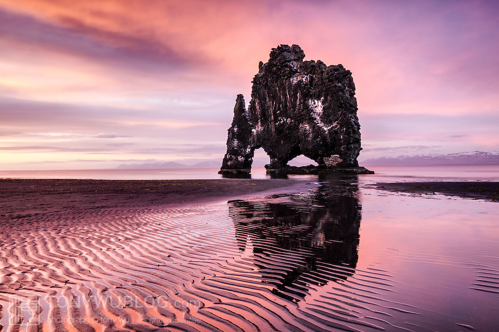 Hvítserkur, a 15-meter tall basalt formation that sits just off the eastern shore of the Vatnsnes Peninsula in Iceland. This monolith is often called the Troll, a reference to the legend of a troll that lived in Strandir. The troll was turned to stone when it did not take shelter from the light of sunrise. The white areas on the rock comprise guano from birds.