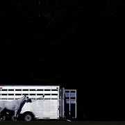 A competion horses tethered to a horse trailer during the Airstream vs. Cinque Terre Polo match at the Greenwich Polo Club, Greenwich, Connecticut, USA. 23rd June 2013. Photo Tim Clayton