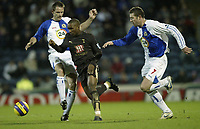 Photo: Aidan Ellis.<br /> Blackburn Rovers v Tottenham Hotspur. The Barclays Premiership. 19/11/2006.<br /> Spurs Jermain Defoe goes past Blackburn's Brett Emerton (R) and Andre OOijer