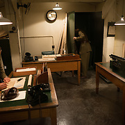 Room 62, the Advanced Headquarters of the GHQ, Home Forces, at the Churchill War Rooms in London. The museum, one of five branches of the Imerial War Museums, preserves the World War II underground command bunker used by British Prime Minister Winston Churchill. Its cramped quarters were constructed from a converting a storage basement in the Treasury Building in Whitehall, London. Being underground, and under an unusually sturdy building, the Cabinet War Rooms were afforded some protection from the bombs falling above during the Blitz.