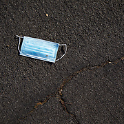Discarded Personal Protective Equipment in the streets.