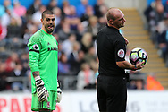 Victor Valdes, the Middlesbrough goalkeeper chats to referee Robert Madley.Premier league match, Swansea city v Middlesbrough at the Liberty Stadium in Swansea, South Wales on Sunday 2nd April 2017.<br /> pic by Andrew Orchard, Andrew Orchard sports photography.