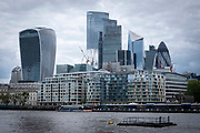 The City of London skyline from the south bank of the river Thames on the 25th of May 2021 in London, United Kingdom.