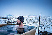 Grindavik, Iceland, 1 apr 2019, Thomas is taking a hot bath outside in the snow.