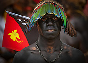 PNG flag, Goroka festival, 140 ethnic tribes come together for three day Sing sing, Goroka, Eastern Highlands, Papua New Guinea