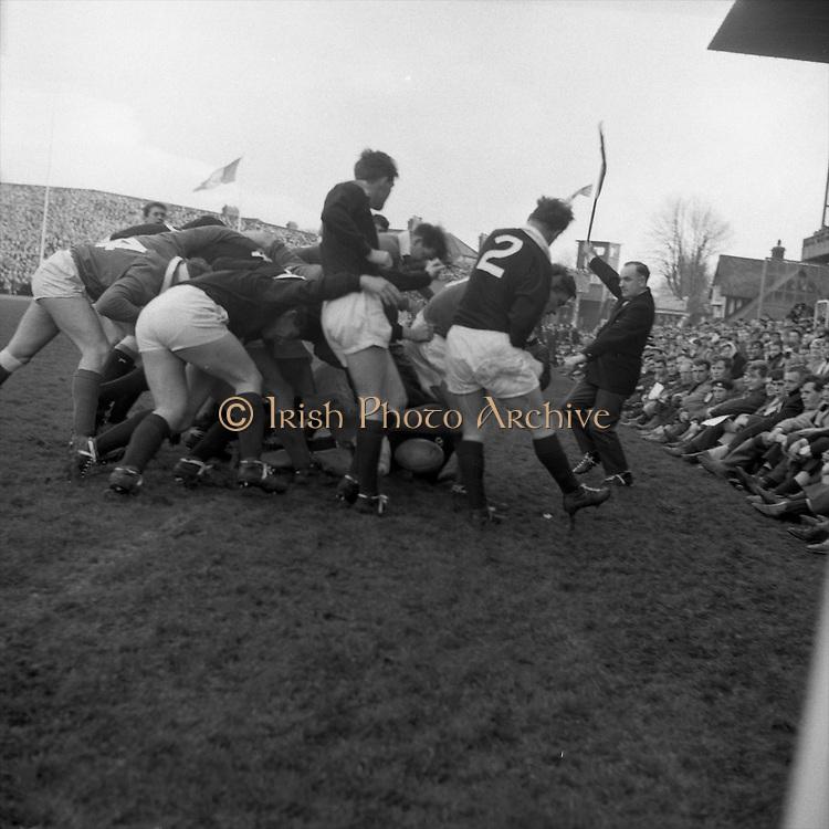 Irish Rugby Football Union, Ireland v Scotland, Five Nations, Landsdowne Road, Dublin, Ireland, Saturday 26th February, 1966,.26.2.1966, 2.26.1966,..Referee- D M Hughes, Welsh Rugby Football Union, ..Score- Ireland 3 - 11 Scotland, ..Irish Team, ..T J Kiernan,  Wearing number 15 Irish jersey, Full Back, Cork Constitution Rugby Football Club, Cork, Ireland,..W R Hunter, Wearing number 14 Irish jersey, Right Wing, C I Y M S Rugby Football Club, Belfast, Northern Ireland, ..M K Flynn, Wearing number 13 Irish jersey, Right Centre, Wanderers Rugby Football Club, Dublin, Ireland, ..J C Walsh,  Wearing number 12 Irish jersey, Left Centre, Sundays Well Rugby Football Club, Cork, Ireland, ..P J McGrath,  Wearing number 11 Irish jersey, Left Wing, University college Cork Rugby Football Club, Cork, Ireland,  ..C M H Gibson, Wearing number 10 Irish jersey, Stand Off, Cambridge University Rugby Football Club, Cambridge, England, and, N.I.F.C, Rugby Football Club, Belfast, Northern Ireland, ..R M Young, Wearing number 9 Irish jersey, Scrum Half, Queens University Rugby Football Club, Belfast, Northern Ireland,..R A Lamont, Wearing number 8 Irish jersey, Forward, Instonians Rugby Football Club, Belfast, Northern Ireland, ..M G Doyle, Wearing number 7 Irish jersey, Forward, Cambridge University Rugby Football Club, Cambridge, England,..N Murphy, Wearing number 6 Irish jersey, Forward, Cork Constitution Rugby Football Club, Cork, Ireland,..O C Waldron, Wearing number 5 Irish jersey, Forward, Oxford University Rugby Footabll Club, Oxford, England, ..W J McBride, Wearing number 4 Irish jersey, Forward, Ballymena Rugby Football Club, Antrim, Northern Ireland,..R J McLoughlin, Wearing number 3 Irish jersey, Captain of the Irish team, Forward, Gosforth Rugby Football Club, Newcastle, England, ..K W Kennedy, Wearing number 2 Irish jersey, Forward,  C I Y M S Rugby Football Club, Belfast, Northern Ireland, ..S MacHale, Wearing number 1 Irish jersey, Forward, Landsdowne Rugby Football Club,