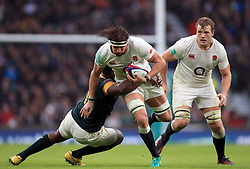 England's Tom Wood is tackled by South Africa's Tendai Mtawarira during the Autumn International match at Twickenham Stadium, London.
