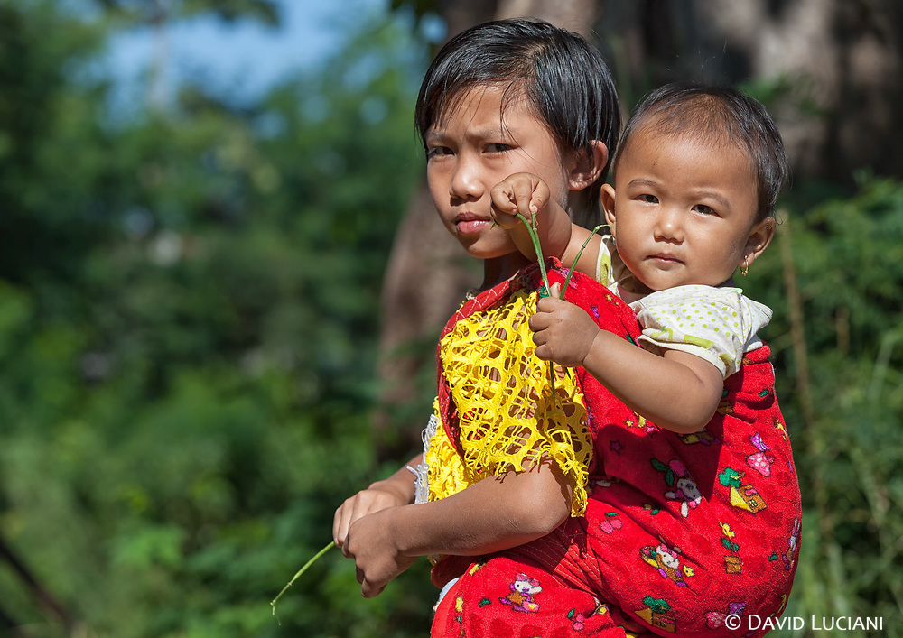 A girl and her young sister, somewhere outside Nyaungshwe.